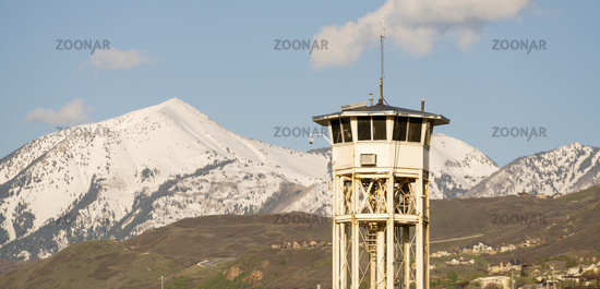 Rusty White Prison Guard Tower Mountain Background