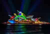 Sydney Opera House illuminated with vibrant moving graphics
