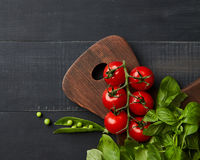 juicy bright summer vegetable on a dark wooden background, flat lay