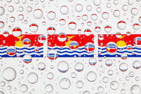 Water drops on glass and Karibati flags.