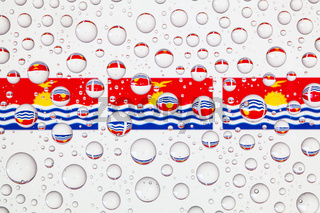 Water drops on glass and Karibati flags.