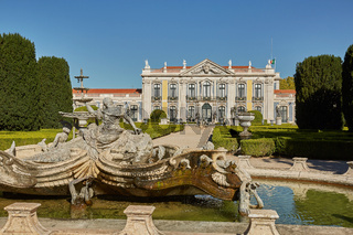 Facade, fountain and gardens of Queluz Palace in Sintra, Portugal during summer day.