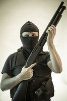 Security, man armed with shotgun and bulletproof vest