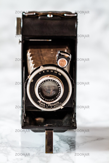 Vintage Folding Camera on Marble Background