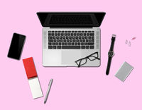 Office desk mockup top view isolated on pink