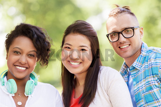 group of happy smiling friends outdoors