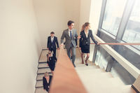 Business people walking the stairs