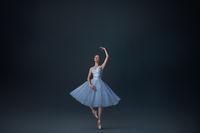 Portrait of beautiful ballet dancer in dark studio