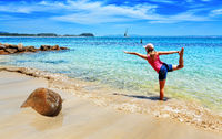 Holiday yoga on a secluded beach