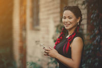 Middle-Aged Pretty Asian with Black and Red Creative Braiding