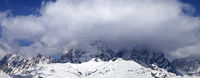 Mount Ushba in clouds at winter