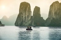 Sunset Over The Fishing Boats And High Rock Mountains At Halong Bay, Vietnam