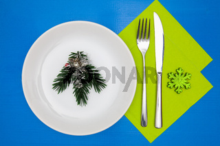 White plate and green Christmas decoration