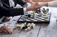 Business people play chess