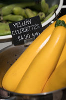 Pile of yellow courgettes on sale