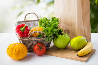 basket of fresh vegetables and fruits on table