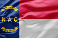 Waving state flag of North Carolina - United States of America