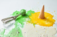 Colorful ice cream cones of different flavors. Melting scoops. Top view, copy space, steel metal background
