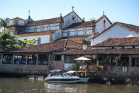 An iconic view of the canal and the colonial houses of the historic town Paraty, Rio de Janeiro state, Brazil
