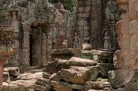 Fallen blocks block courtyard by temple doorway