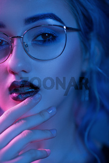 Sexy woman in glasses with evening makeup
