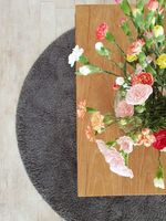 Flowers on wooden table, top view colorful bright interior