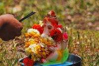 Ganesha puja before its immersion inside water Pune, India.