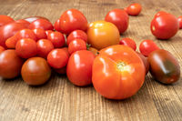 Organic tomatoes on wooden table