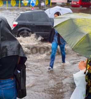 People in flooded rainy city