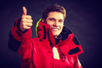 Cheerful man with weatherproof gear