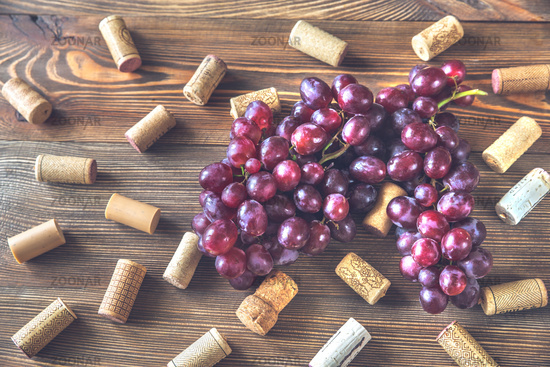 Bunch of grapes on the wooden background