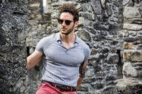 Attractive man outdoor in old European castle