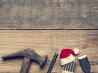 Old carpenter tools with the hat of Santa