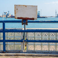 White blank grunge rusted sign attached to blue old metal fence revealing Suez Canal