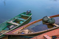 Neglected empty wooden fisherman boats