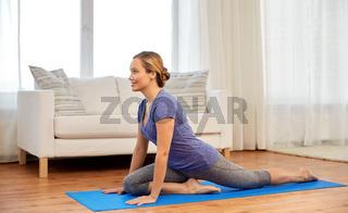 woman doing swan yin yoga pose at home