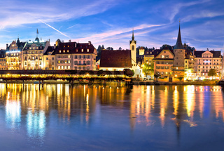 Luzern Kapelbrucke and riverfront architecture famous Swiss landmarks evening view
