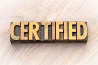 certified word abstract in wood type