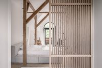 Stylish bedroom in modern style with wooden beams
