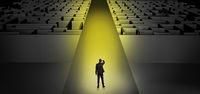 Businessman going straight on two dark mazes