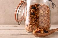 Closeup of a storage jar filled with Homemade granola