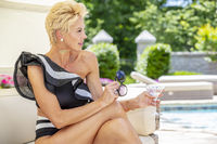 Gorgeous Blonde Model Posing Outdoors Near A Swimming Pool