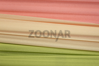 lime green, cream and salmon crepe paper background