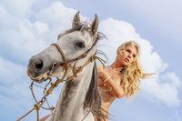 Nude Hispanic Brunette Model And Horse On A Caribbean Beach
