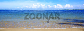 Caribbean sea and blue clouds sky. Travel background.