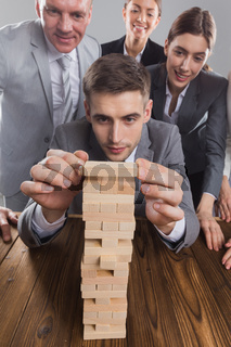 Business people building wood tower