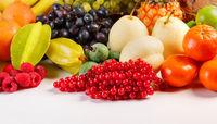 Fresh fruits pile on white