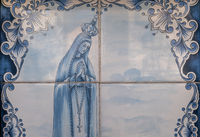 A painted tile artwork with image of Virgin Mary