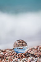 Sveti Stefan old town reflected in glass ball