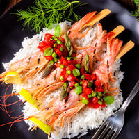 grilled red argentine shrimps with red salsa and green asparagus